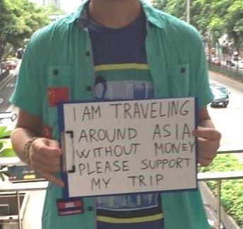 man holding sign begpacking