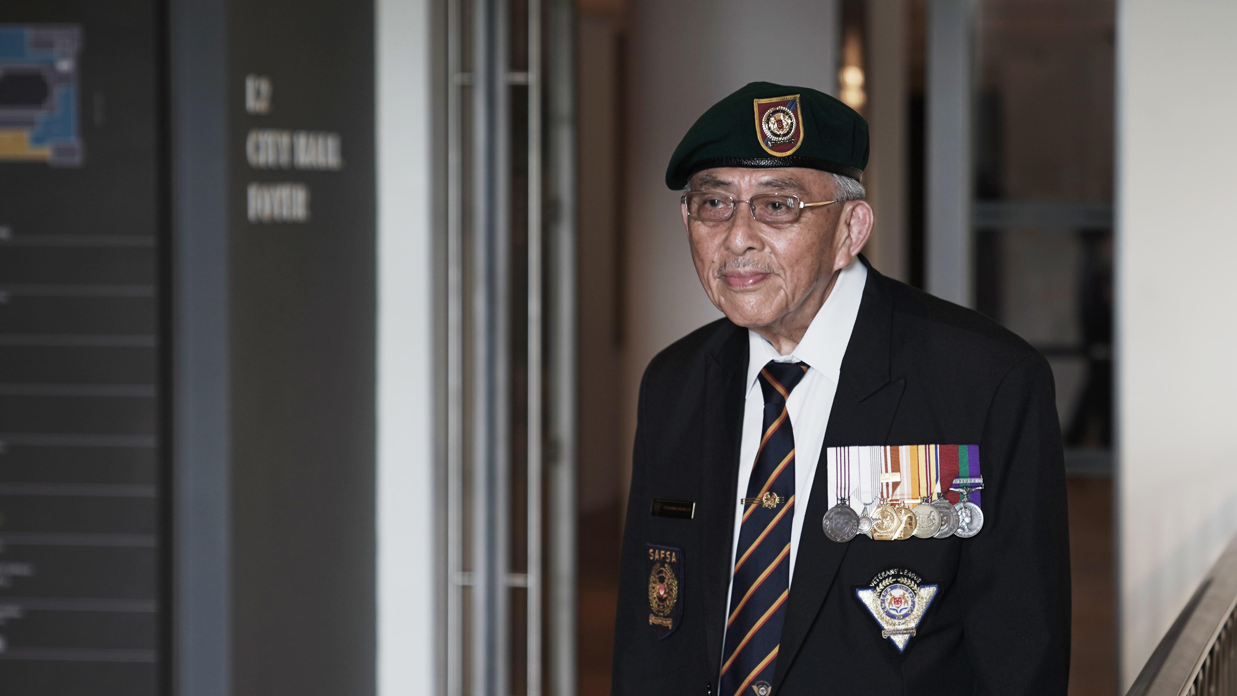 Captain (Ret.) Hong Seng Mak after the flag raising ceremony.