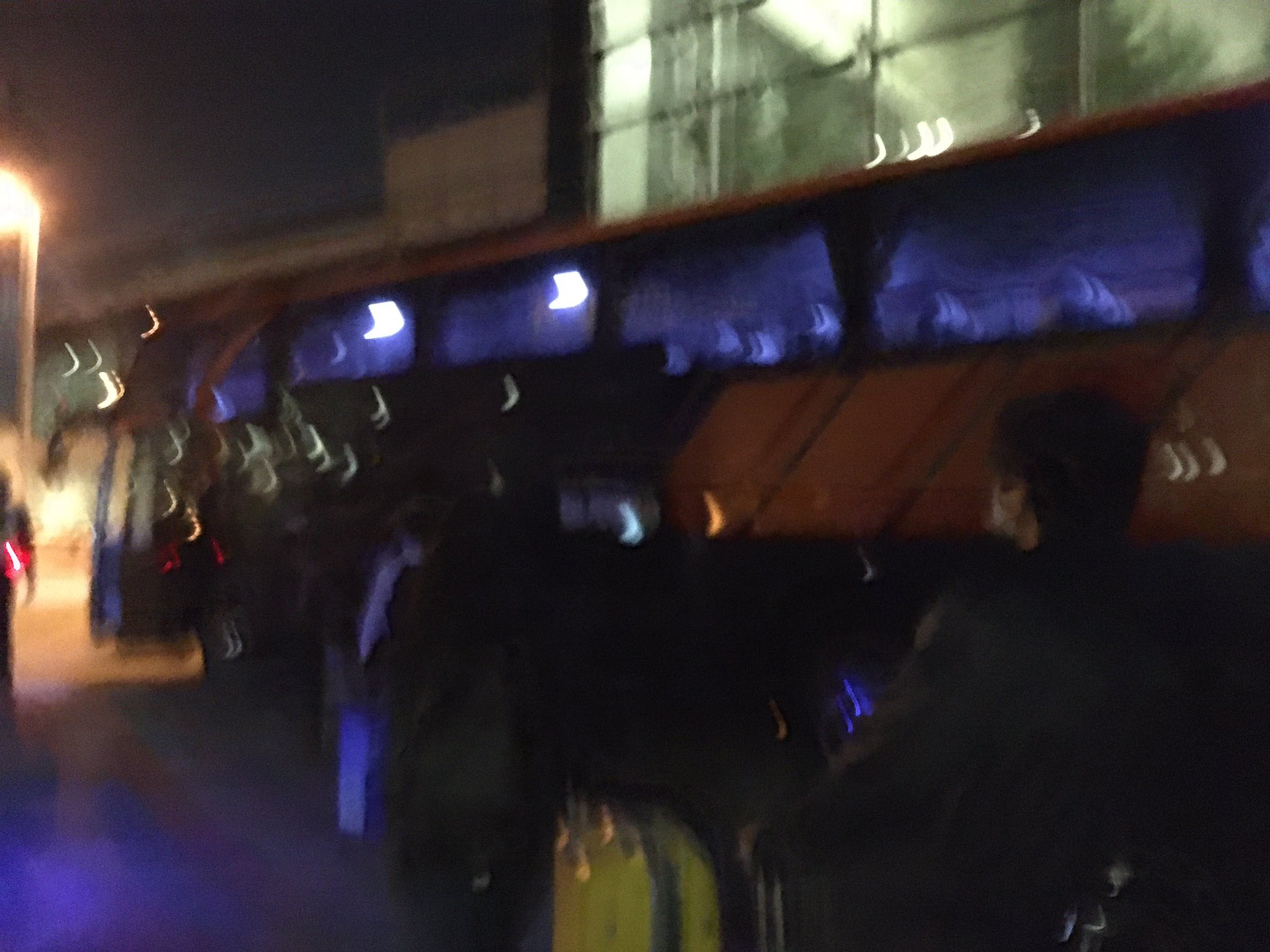 blur photo of people boarding bus for SHN