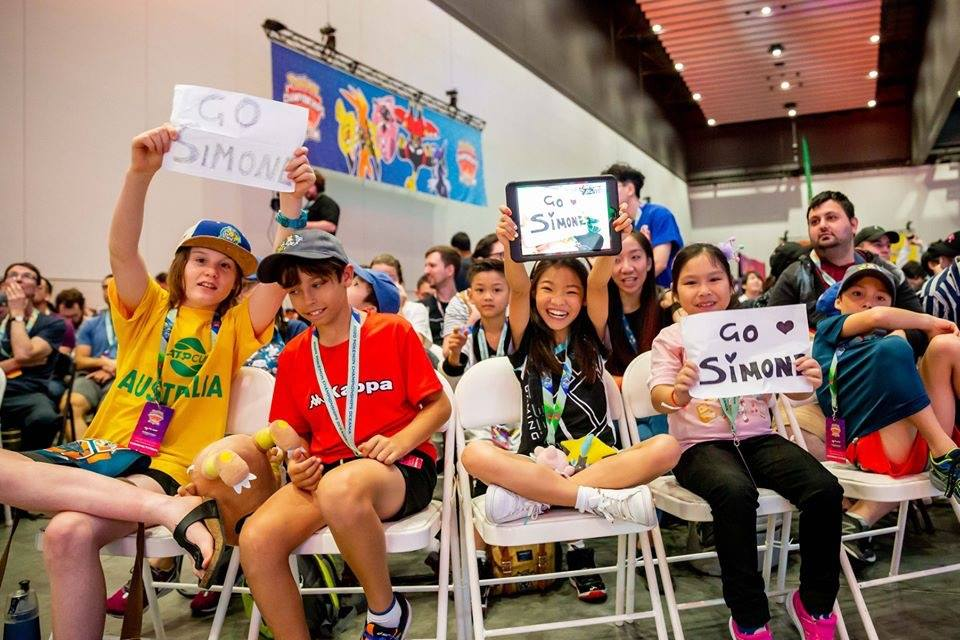 Simone Lim's friends cheering for her at the Oceania International Championship Finals