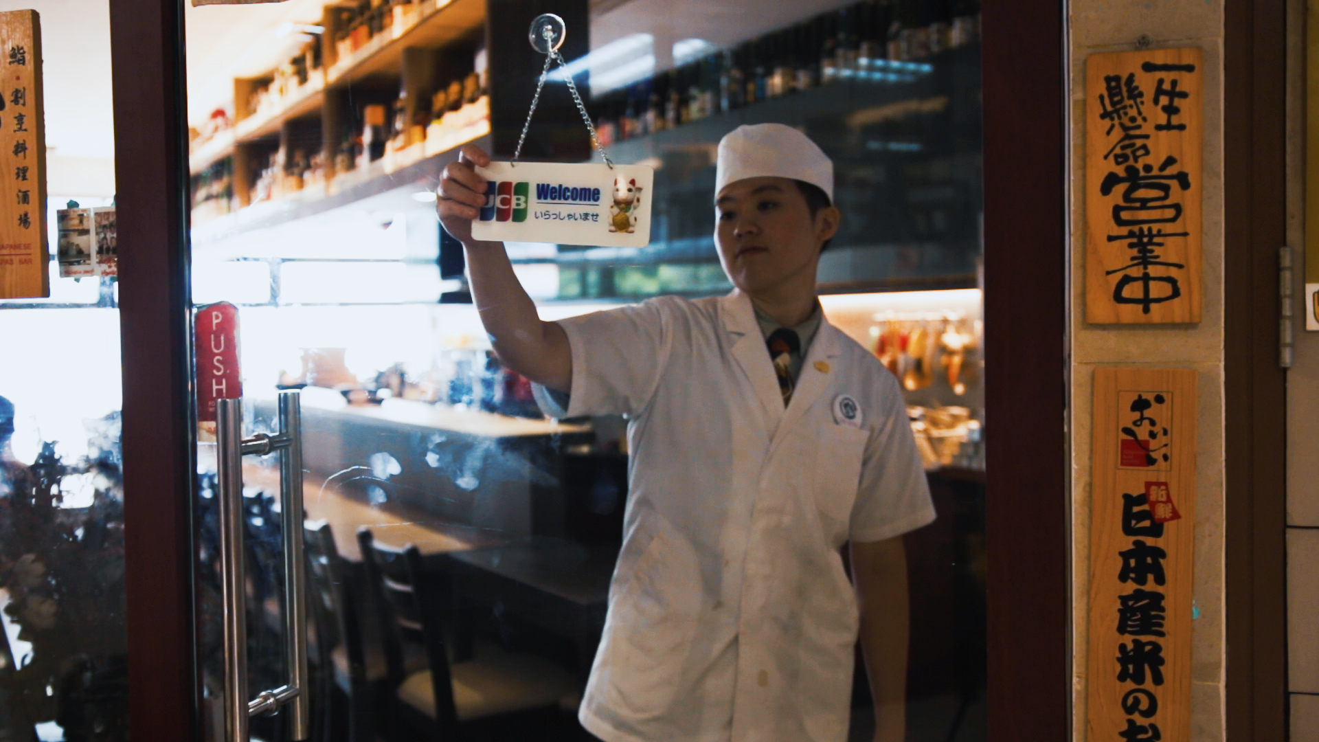 Sushi Chef Aeron Chan opens shop welcome sign