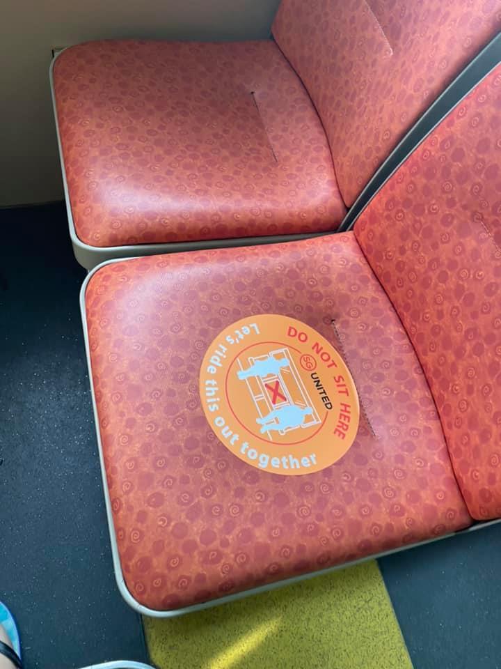 safe distancing sticker on sbs bus