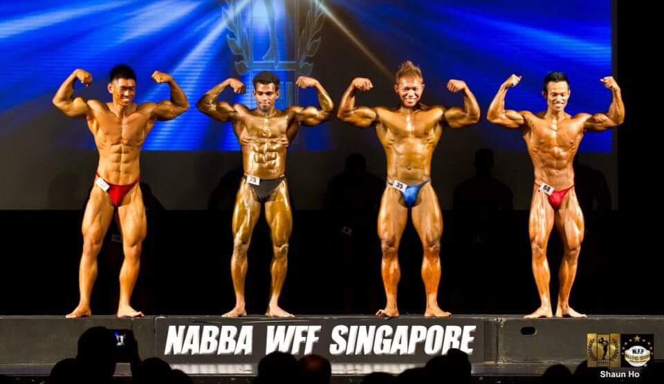 Image of Murugesan at a bodybuilding competition in Singapore