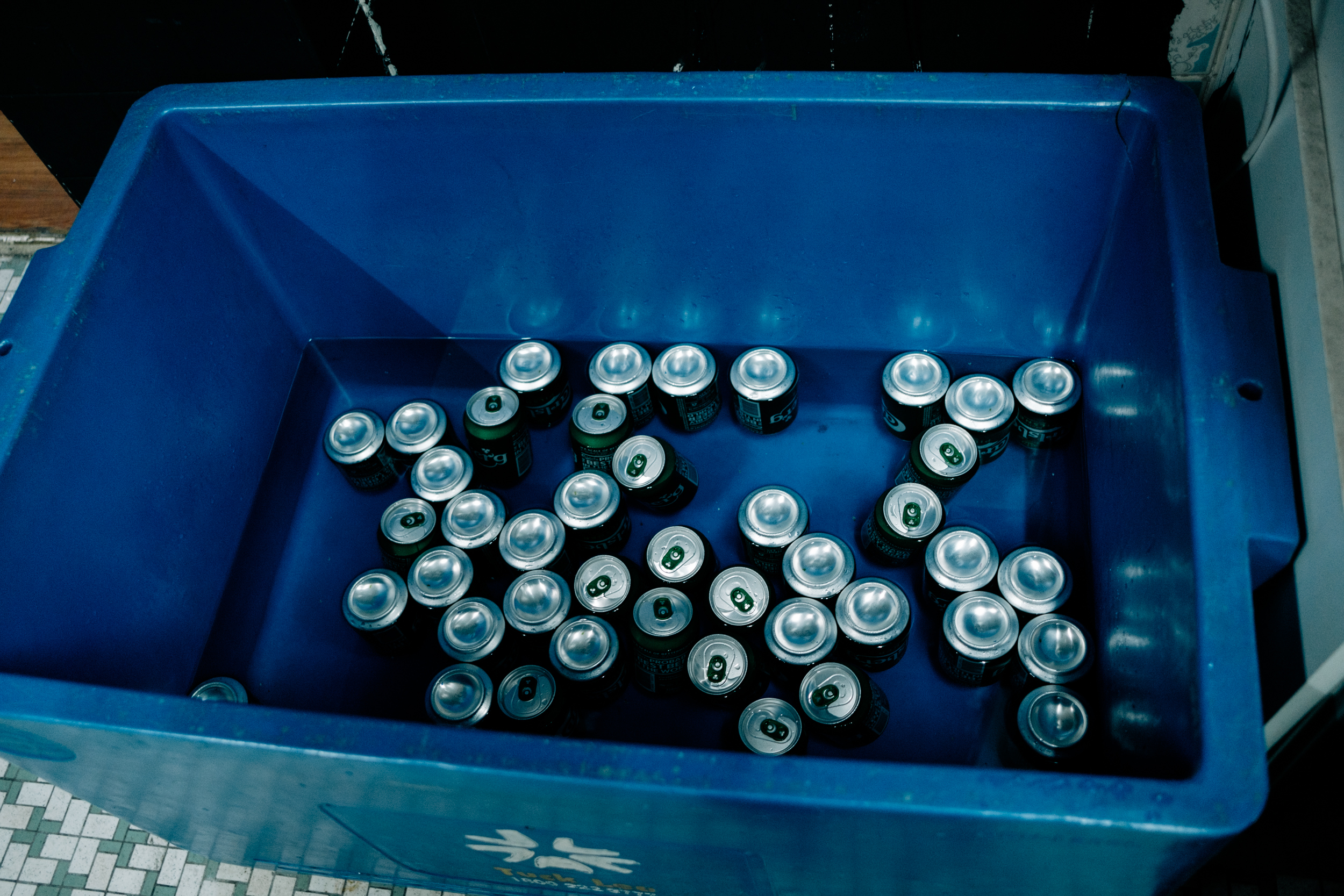 Image of cans of beer in a cooler