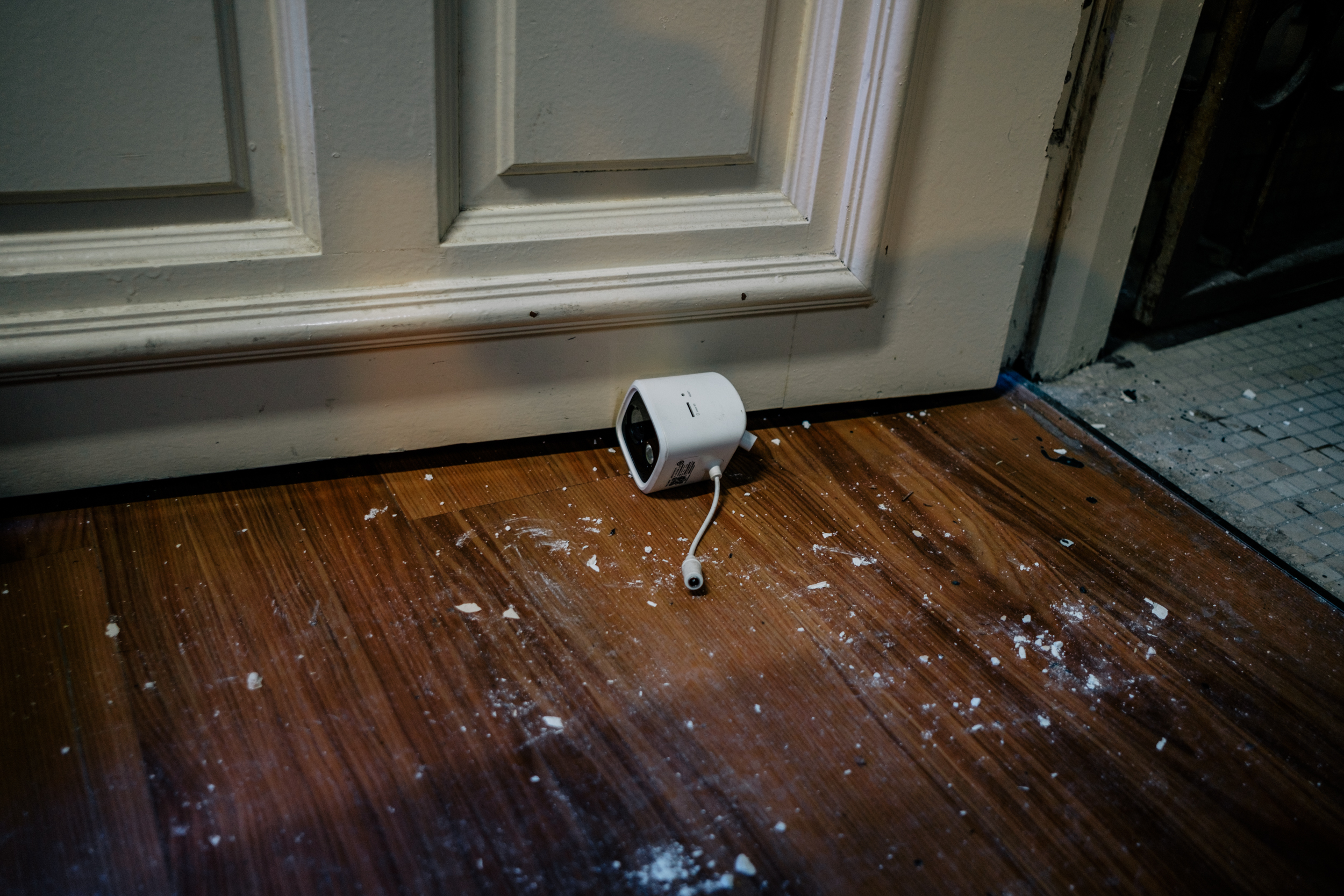 Image of the CCTV lying by the foot of the door.