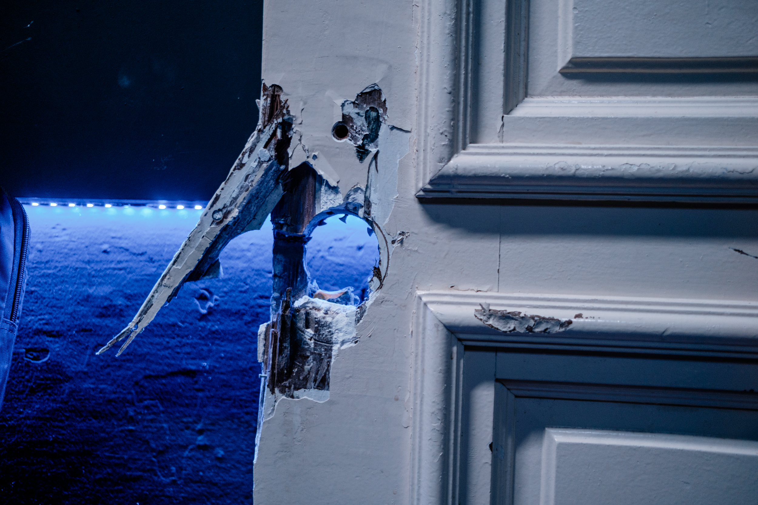 Image of the busted door missing a knob.