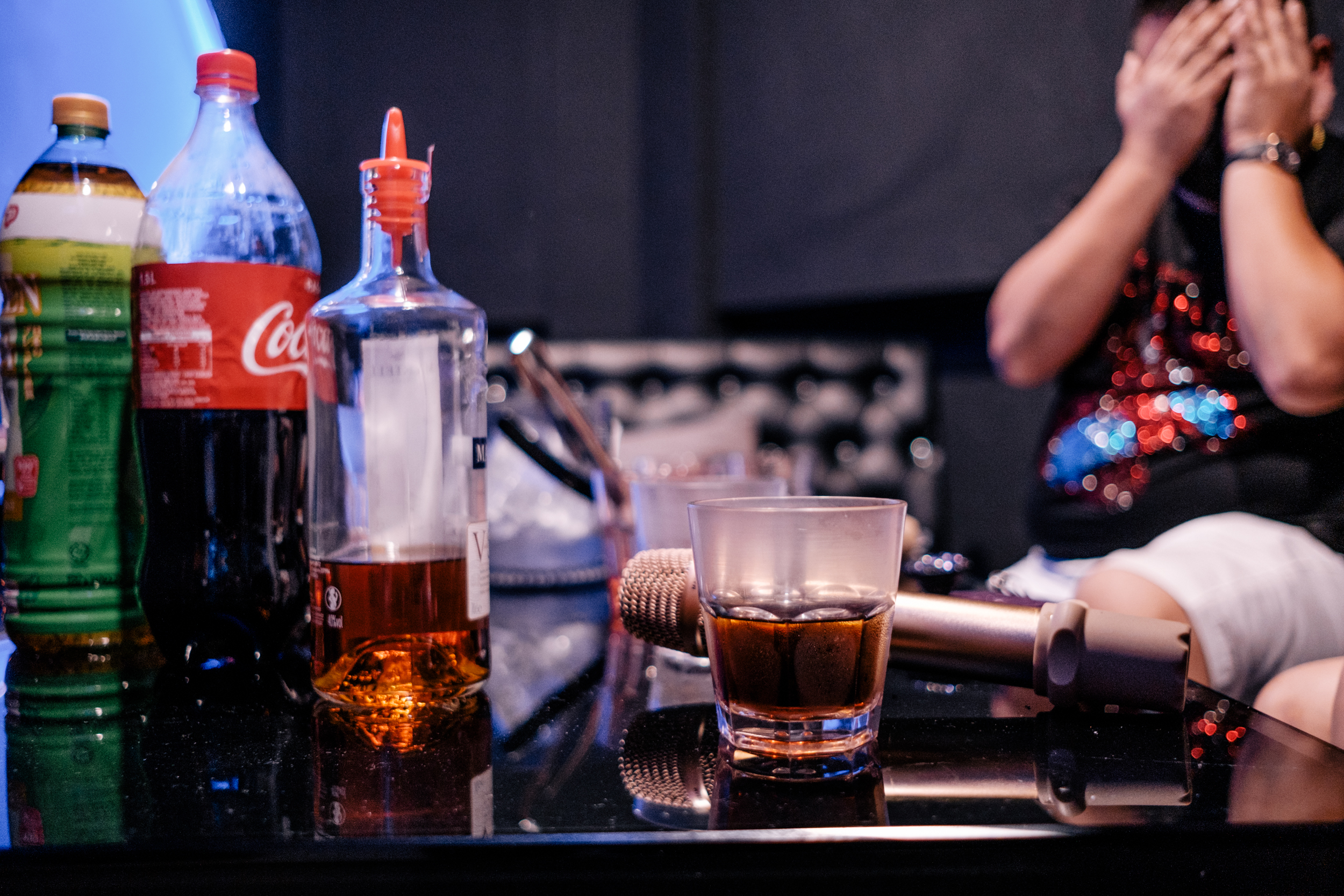 Image of the liquour and microphone on the table in the illegal KTV
