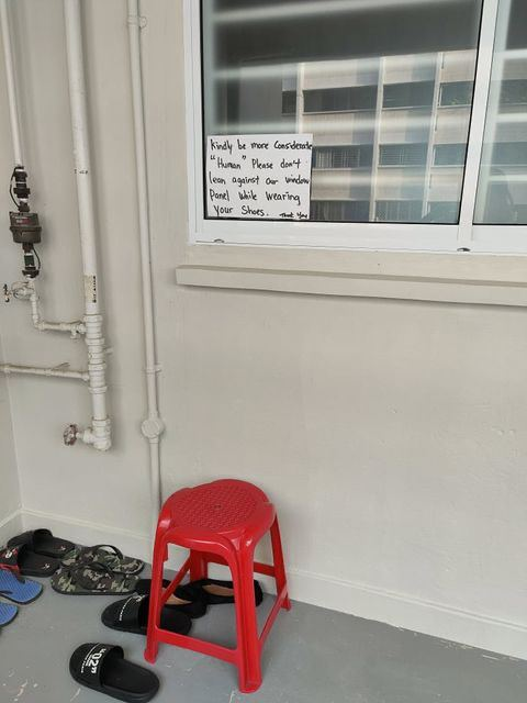 Chair placed under sign on window
