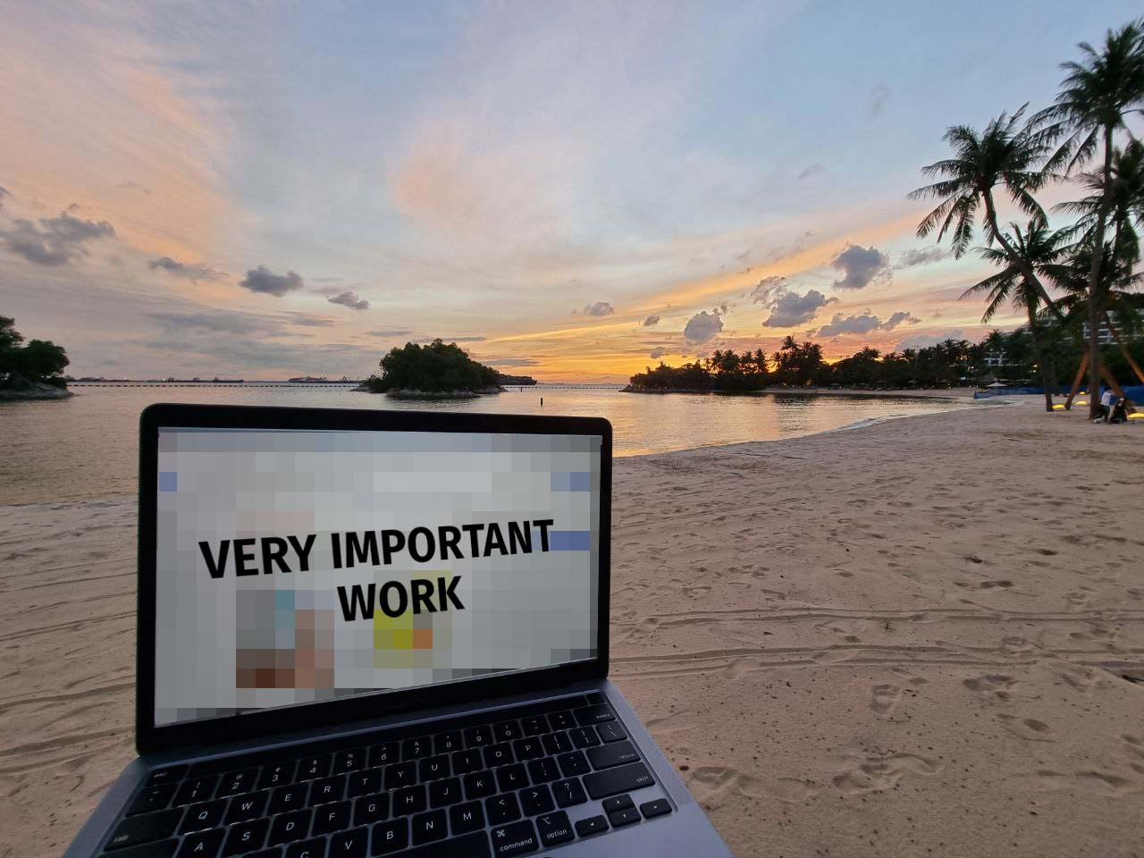 Image of writer working on the beach